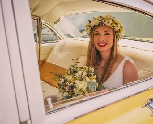 a bride in her Cadillac wedding car