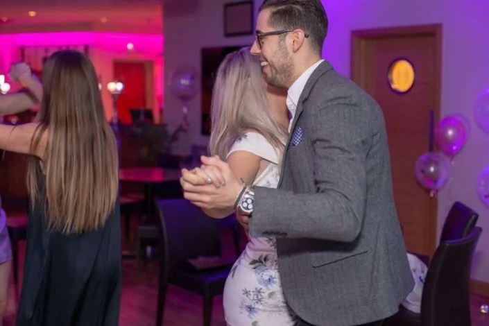 A couple dancing at a birthday celebration