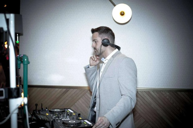 DJ behind Pioneer CDJ decks