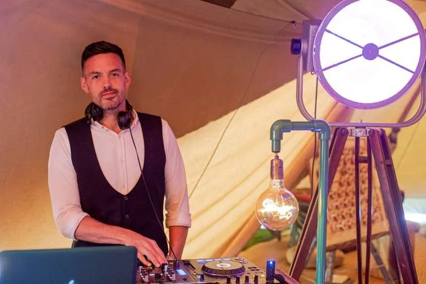 A cool wedding dj behind pioneer decks