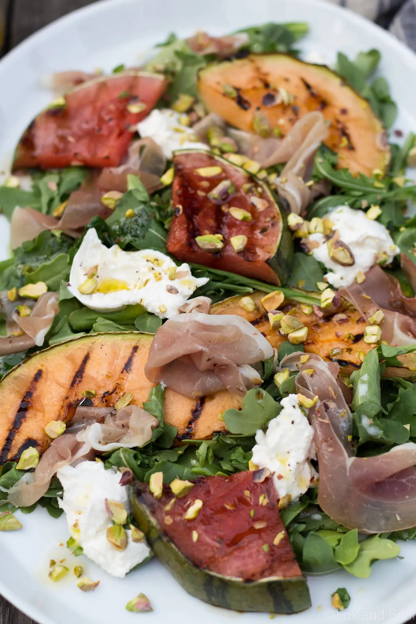 This Grilled Melon Salad with Prosciutto and Burrata is a light dinner perfect for a hot summer day!