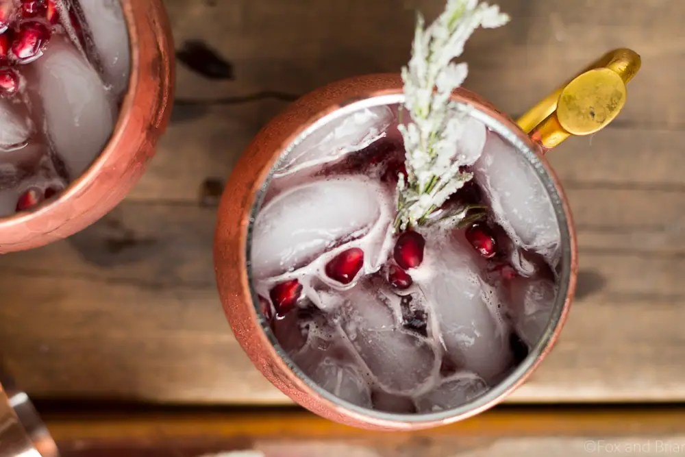 This Pomegranate Irish Mule is the most festive Mule of them all! Pomegranate Juice, ginger beer and whiskey makes this an easy and delicious wintertime cocktail!