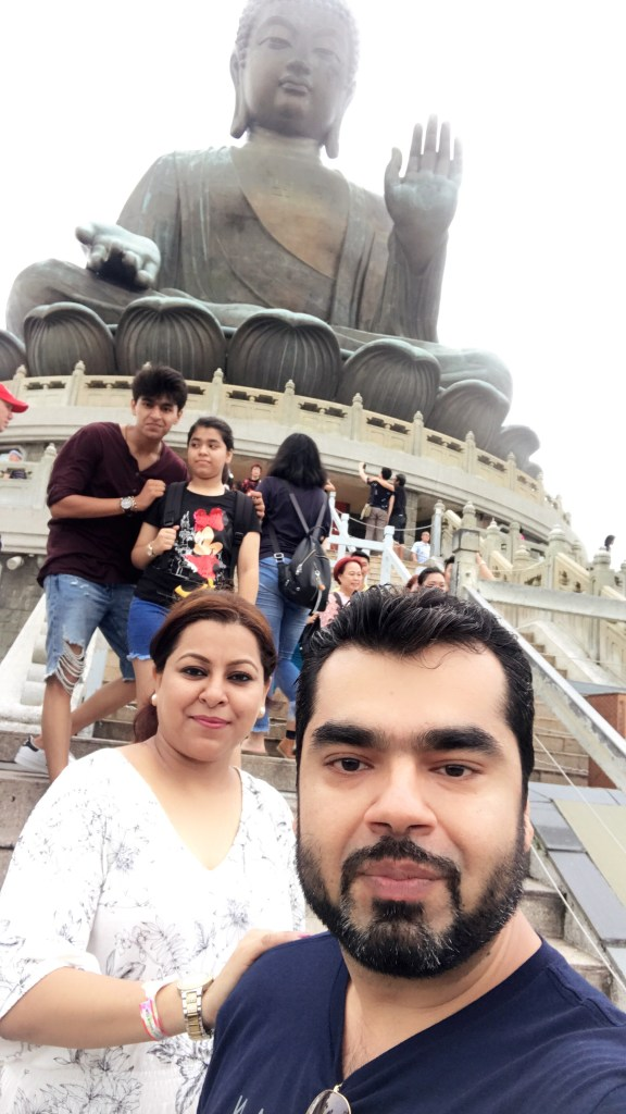 Vinish with family at Tian Tan Buddha, Hong Kong.