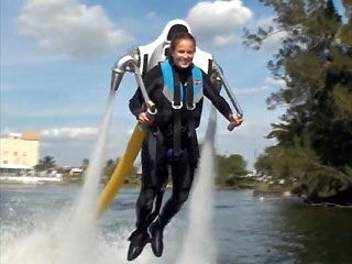 A young woman goes airborne using the JetLev water-powered jetpack. ( MS Watersports GmbH)