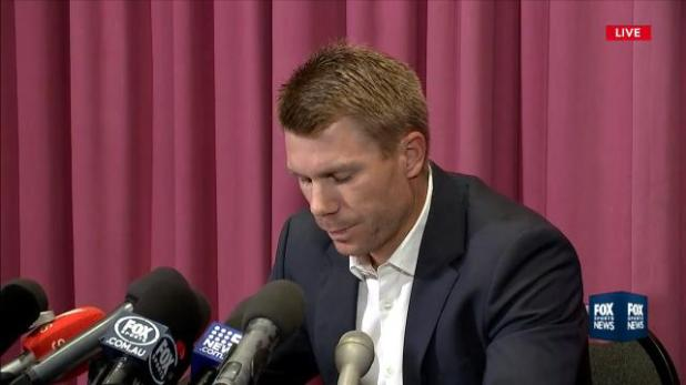 Warner confronts the media