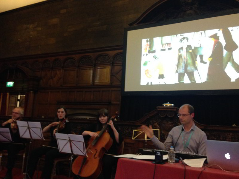Live orchestral performance of Lowry at Sheffield Doc Fest conducted by composer Edmund Joliffe