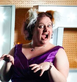 Photo of Caroline, Foxy Chocs head chocolatier, roaring like a lion while wearing fox ears