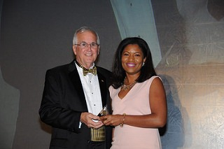 Woman accepting FPRA award of recognition.