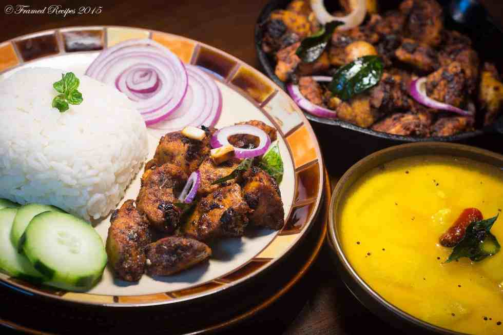 CHICKEN FRY SERVED WITH RICE, ONION RINGS, CUCMBER SLICES, AND MORU CURRY