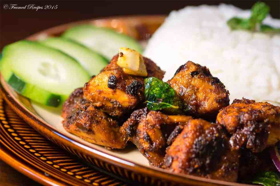 chicken fry served with rice. cucumber slices