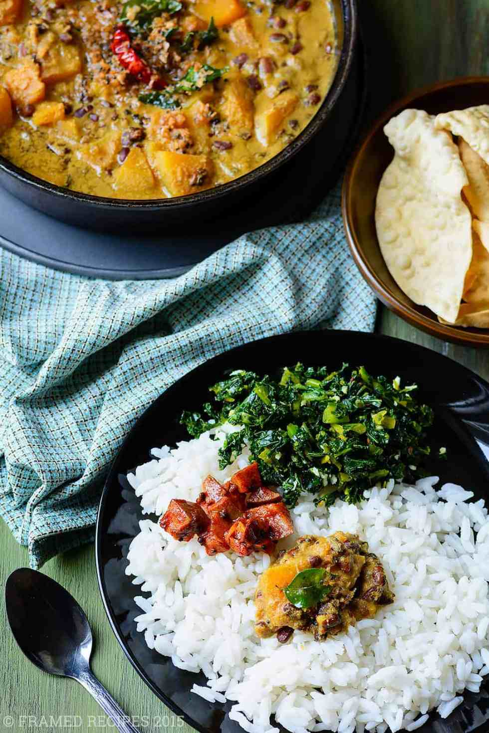 erissery served with steamed rice, kale thoran, pickle, and pappadam.