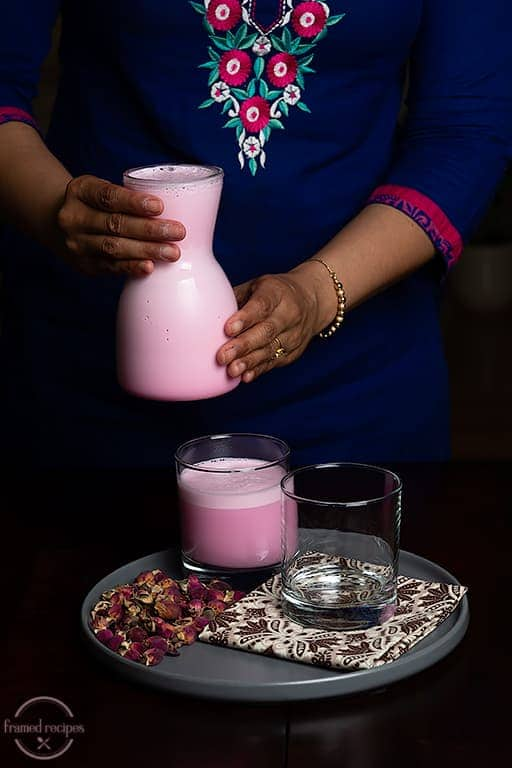 ready to pour rose milk into serving glass.