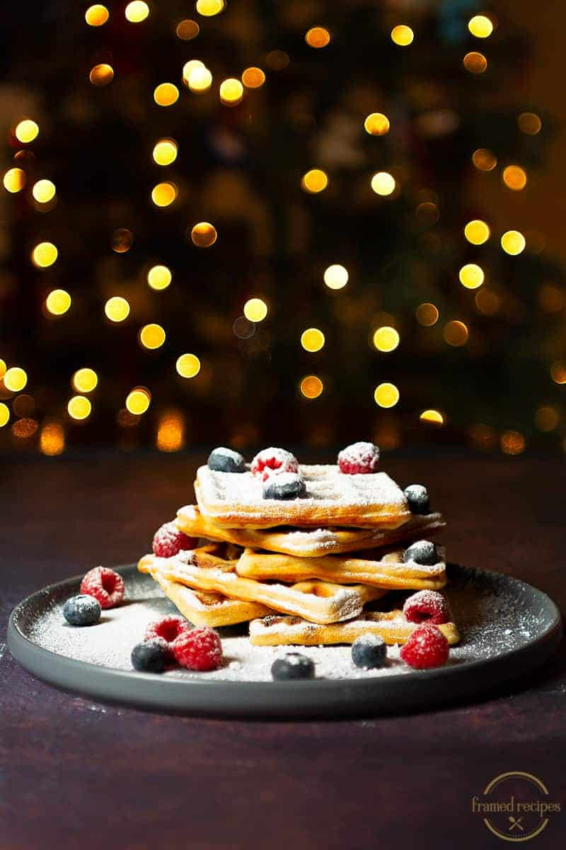 Yeasted_Oats_Waffles_WITH_CHRISTMAS_LIGHTSIN THE BACKGROUND