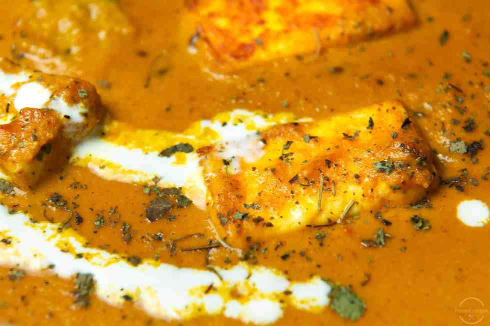 Paneer in an aromatic gravy garnished with cream.