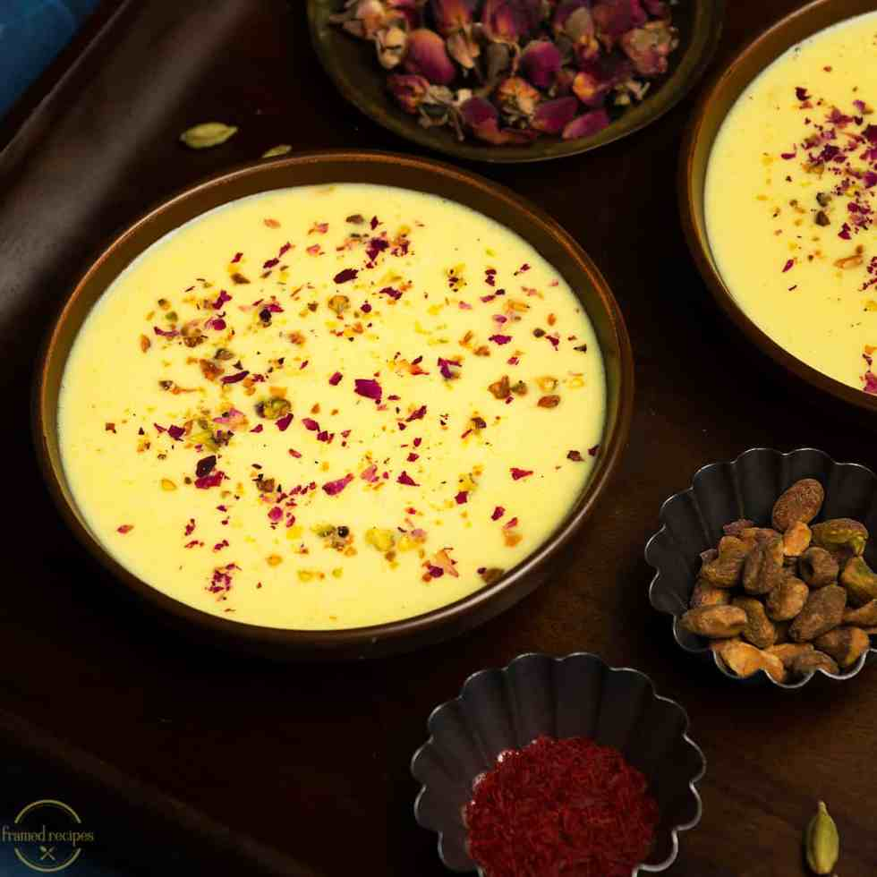 eggless tapioca pearl pudding with apples garnished with dried rose petals and crushed pistachios.