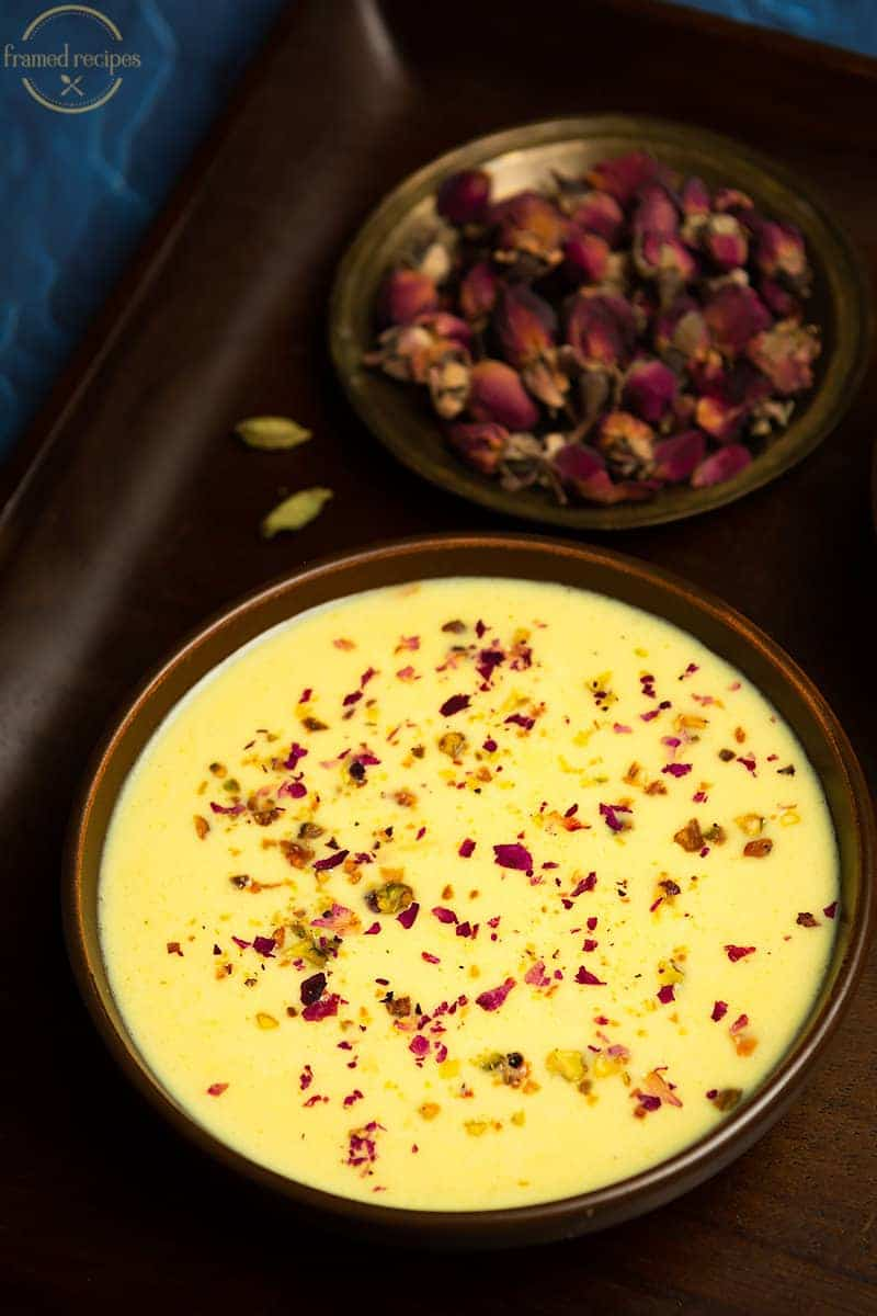 sabudana apple kheer with flavors of saffrona nd cardamom garnished with dried rose petals and crushed pistachios.
