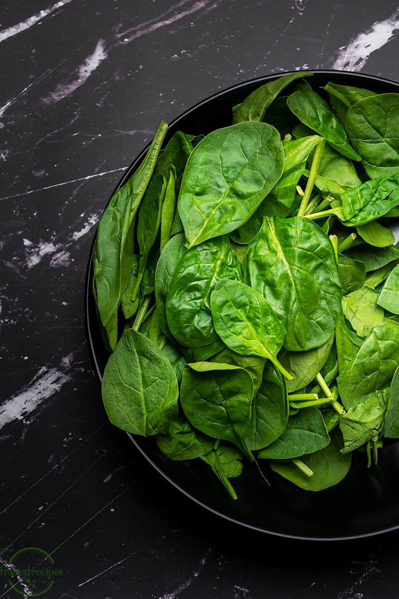 a bowl full of baby spinach