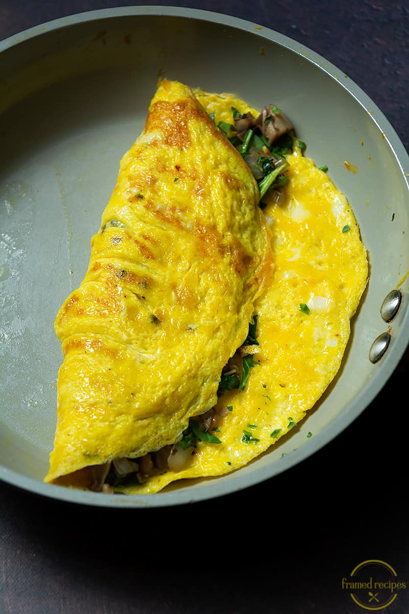 mushroom and spinach filled omelet folded into half