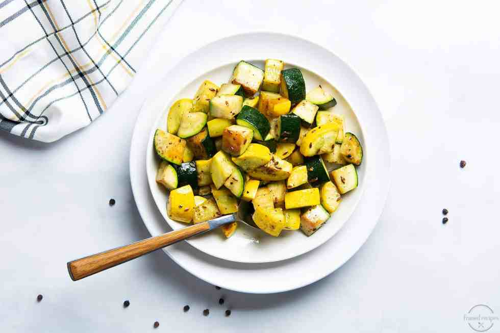 tender crisp zucchini and yellow squash pan roasted with cumin and black pepper