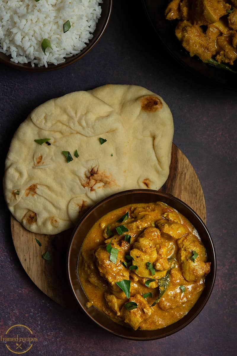 chicken curry served with rice and naan