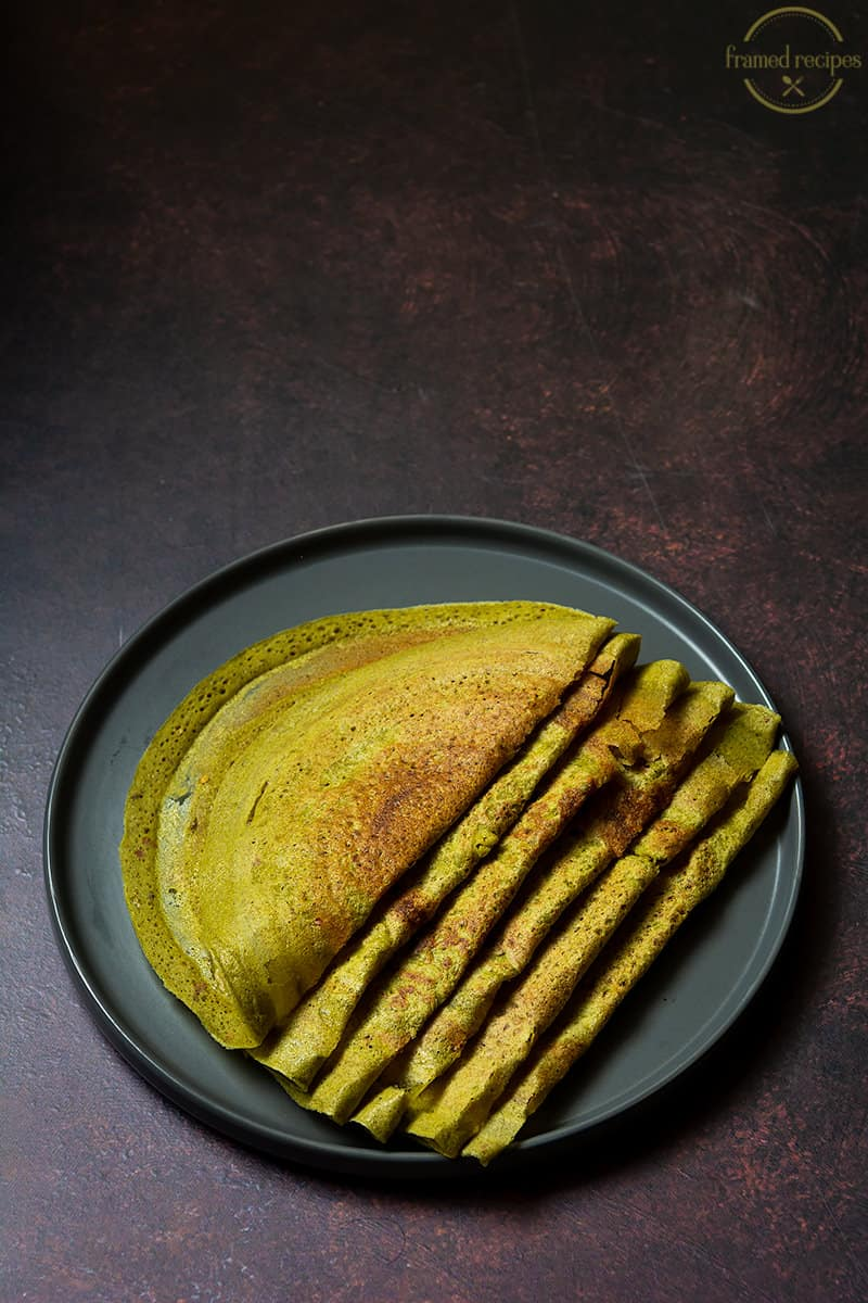 thin crepes made using overnight oats & moong beans