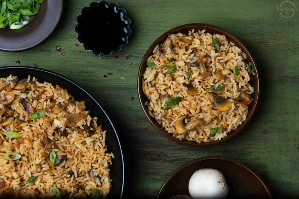 mushroom fried rice shown with spring onions, mushrooms, and soy sauce