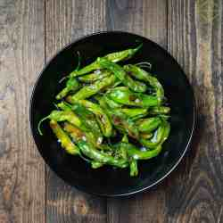 blistered shishito peppers ready to serve