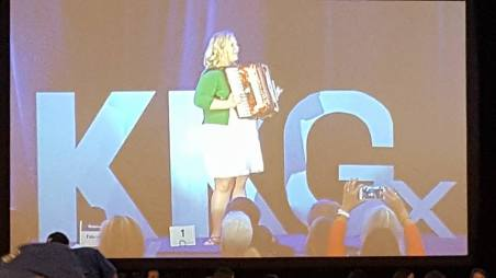 Kylie Towers Smith on stage at Kappa Kappa Gamma's convention in San Diego. I suspect she is playing a Kappa song.