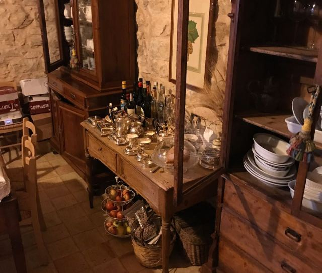 The Stove And Stone Sink Door Opens To Garden Tables Where Breakfast Is Served