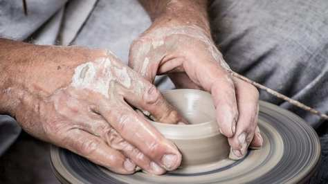 Potter using a wheel to create a pot