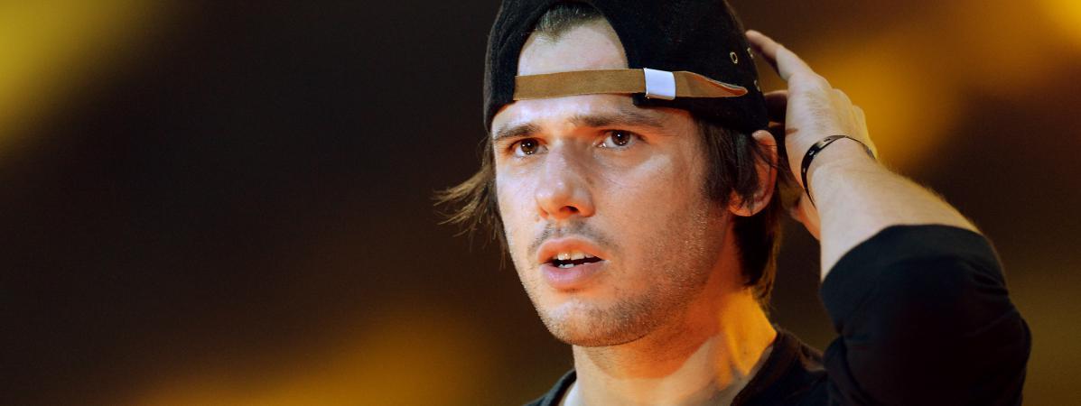 Orelsan, sur scène pendant un concert Urban Peace, le 28 septembre 2013, au Stade de France.