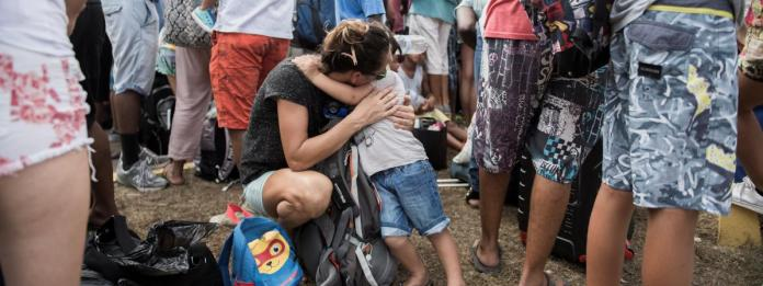 A mother and her child are waiting to leave the island of Saint-Martin on September 10, 2017.