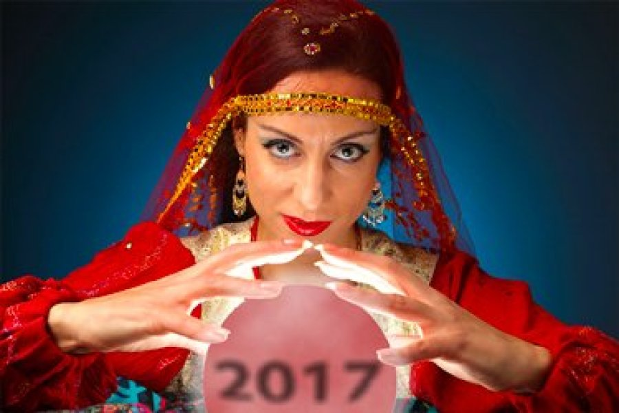 "Fortune teller with crystal ball containing the numbers ""2017"""
