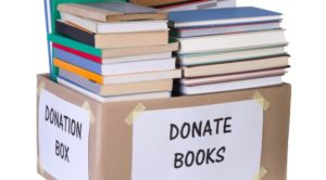 Book-Donation-Box-with-Pile-of-Books-672x372