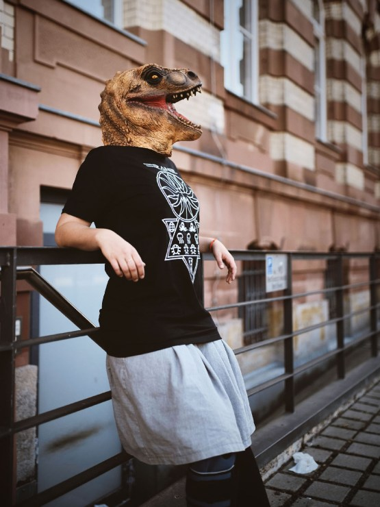 AbyssalCult Shirt worn by T-Rex masked person leaning on rail