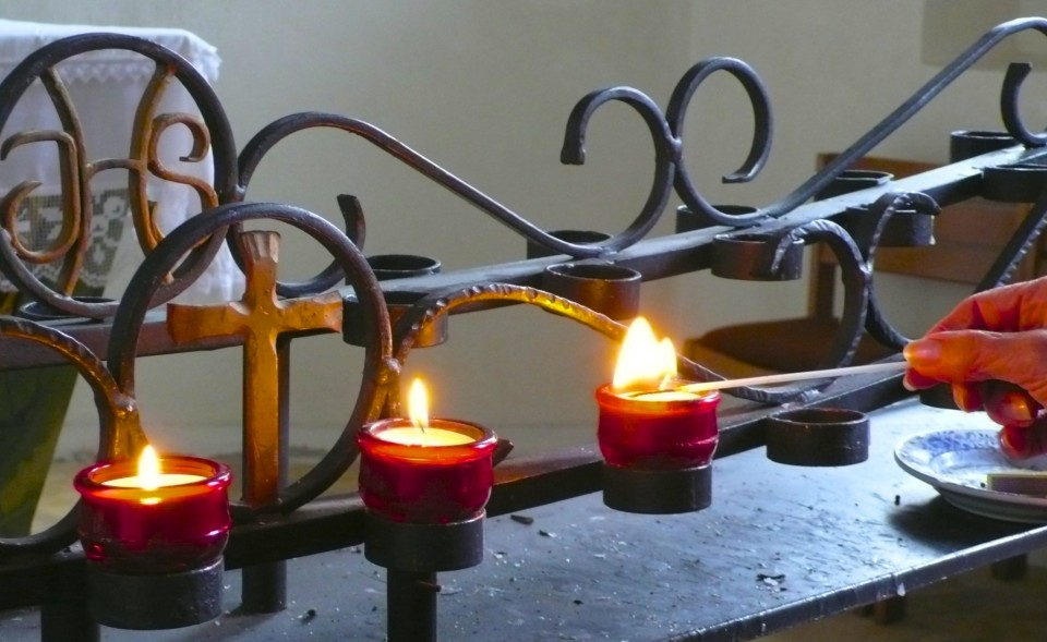 Back in the lowlands, we stop in a chapel to light candles and I say a prayer of gratitude.