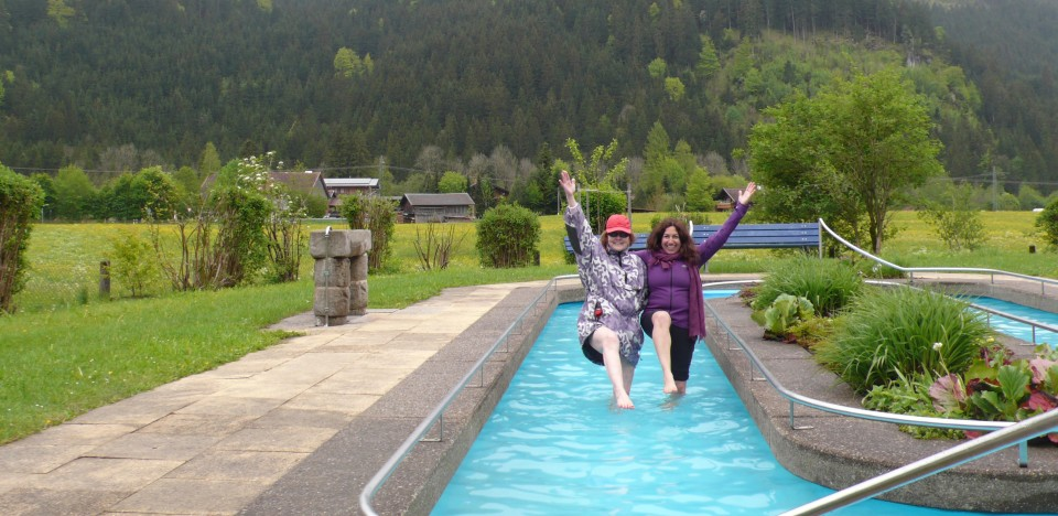 """Ursula and Fran """"stork walking"""" in the freezing Kneipp Foot Bath, also known as Kneipp Hydrotherapy."""