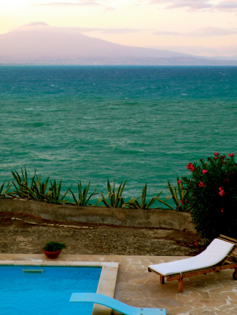 Our view at the villa while doing yoga!  Mount Etna across the bay.