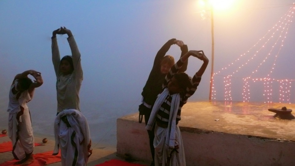 Morning yoga on the Ganges before sunrise, in a deep fog.