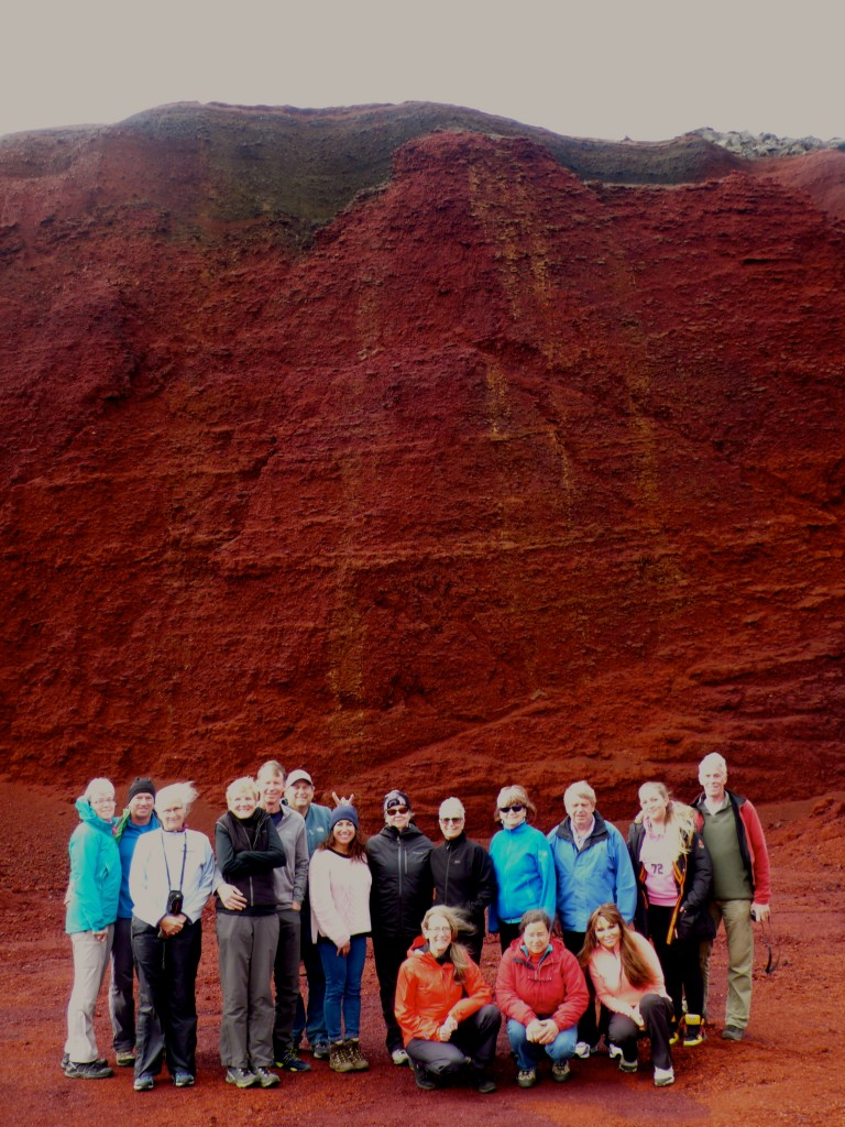 "Our group! The color of the lava is such a deep red.  The dark layers behind us is a layer of ash.  Jeff Bigman is giving me ""rabbit ears"".  I'll have to get him back!"
