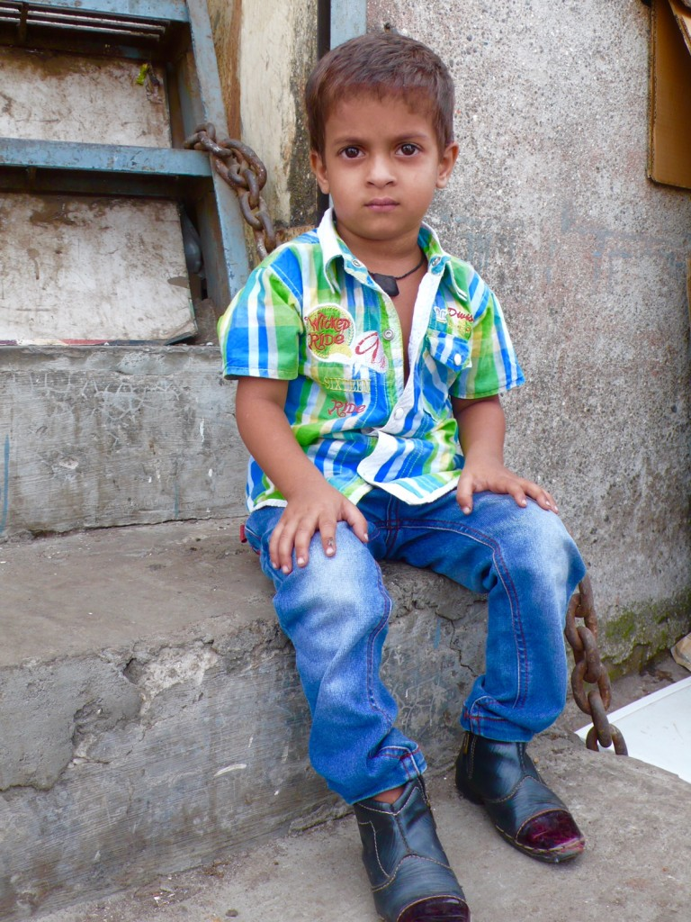 Another adorable child! I sat by him for a little while and showed him that we had the same boots. He was delighted. The children were clean and looked to be well fed. They appeared to be very happy and well loved.