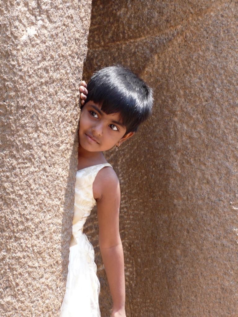Another one of my favorite photos of the day!!!  This little girl was playing hide and seek with her brother amid the giant granite elephants at the Shore Temple.