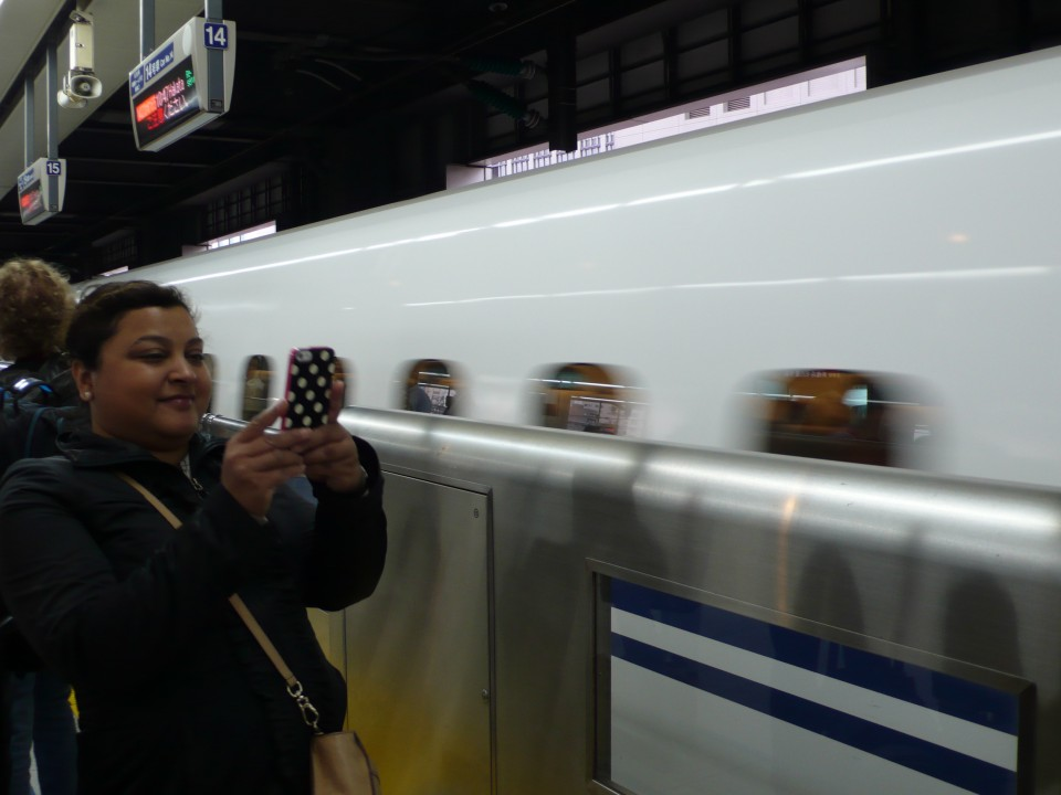 Divya photographs a bullet train speeding by!