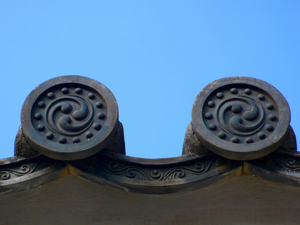 Detail: the ends of the tiled roofs are always in the shape of waves. The waves were thought to help thwart fire in the wooden buildings.