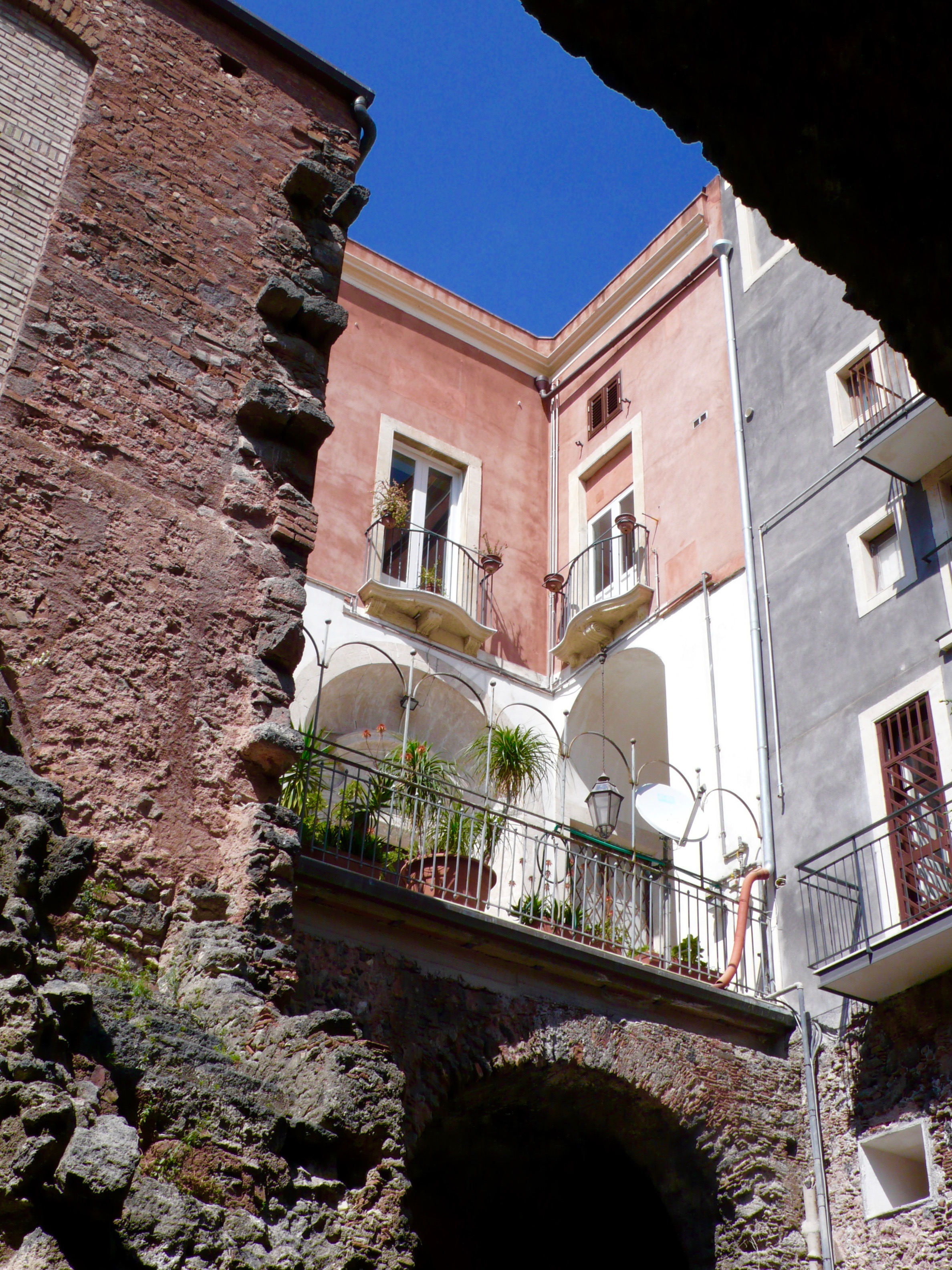 Homes built right over the Roman Amphitheater Ruins in the center of the city