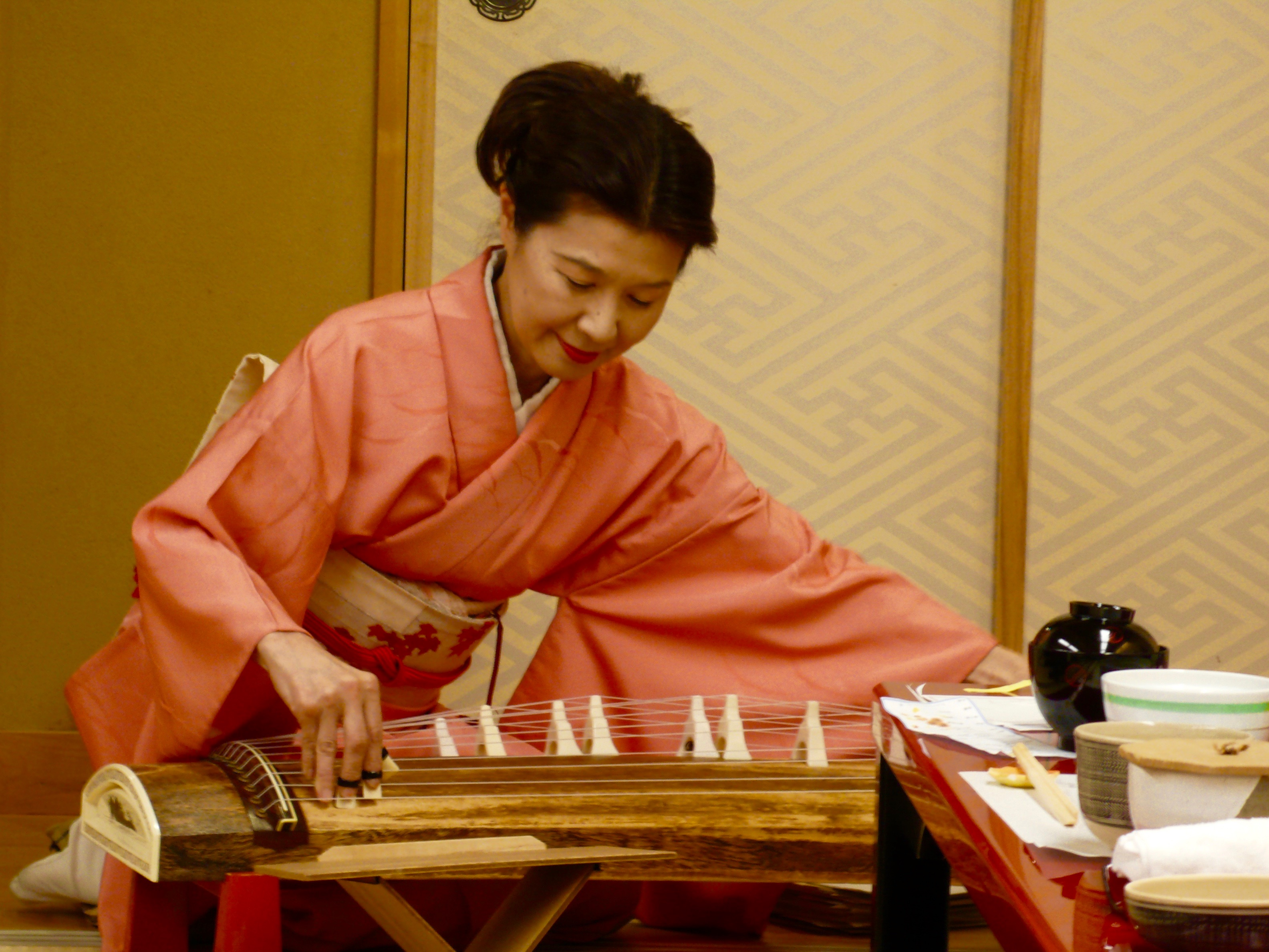 This musician played the koto for us in Kyoto.  The music is so ethereal.  She was so lovely, too, and so accomplished.  Her English was nearly perfect. Plus she did yoga three times a week!  She blushed when she told me about being a yoga practitioner!