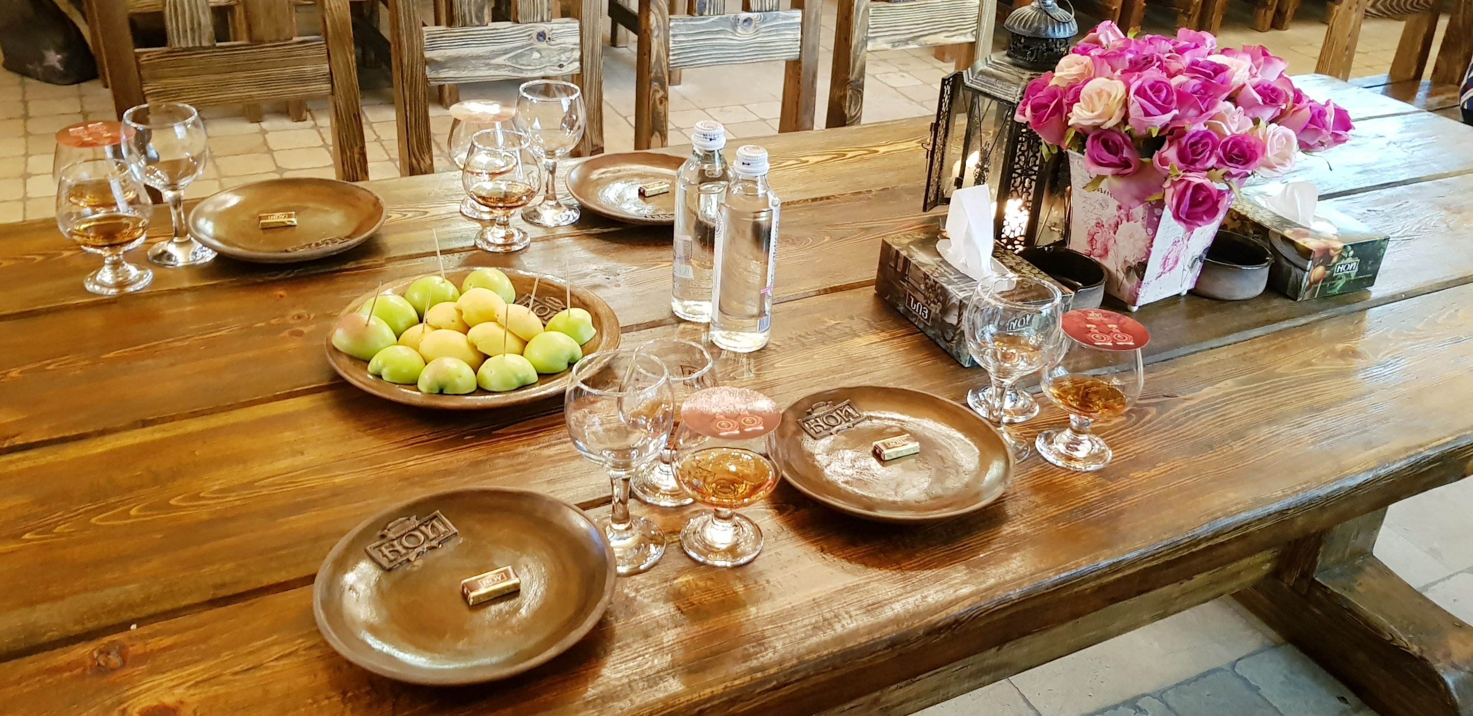 Table setting with brandies and roses