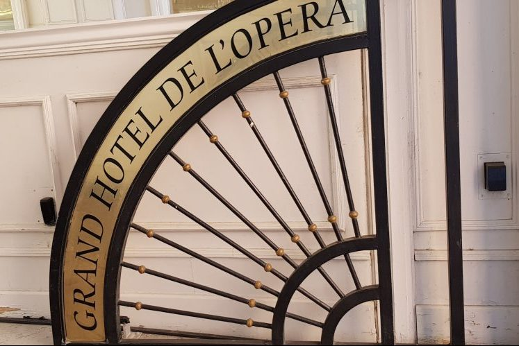 Welcoming sign to Grand Hotel de l'Opera in Toulouse
