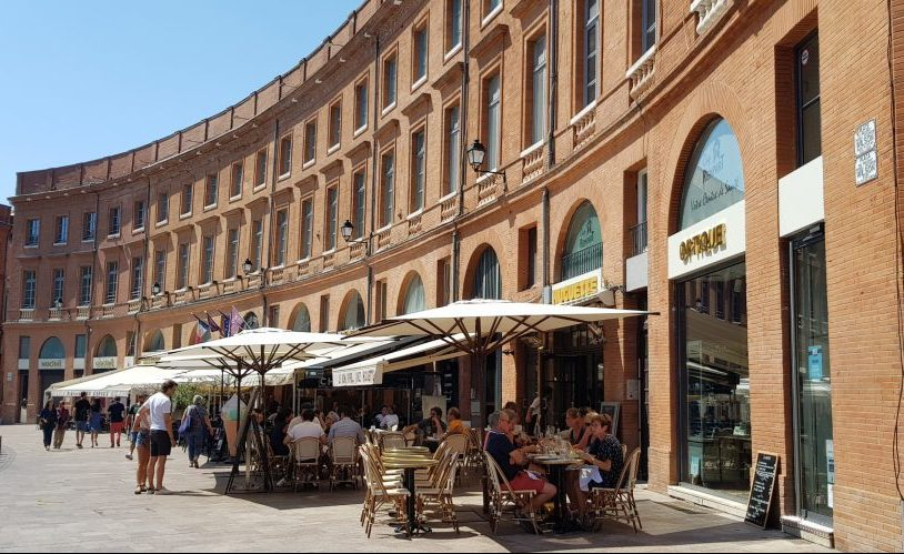 People watch on Place du President Thomas Wilson in Toulouse