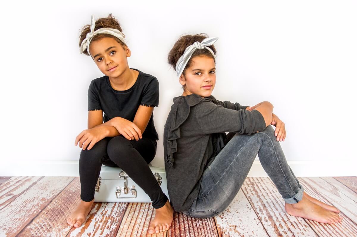 Two girls with Frankie & Lola headwear
